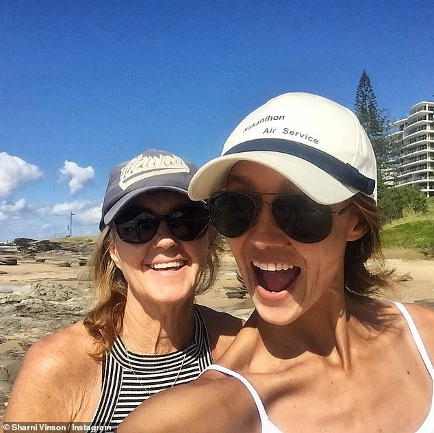Away from danger:Sharni, who grew up in Cronulla, is currently staying on the Sunshine Coast with her mother (left) and two dogs, while the rest of her family are in Sydney