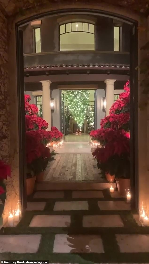 Pretty: Guests gathered at the 40-year-old reality star's $8.5M 12K-square-foot mansion inside the gated community, Estates at the Oaks, were greeted by rows of poinsettia plants