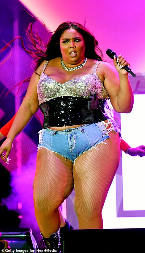 Fun times: Lizzo - whose real name is Melissa Viviane Jefferson - looked in high spirits as she laughed and chatted to the crowds while on stage in Los Angeles