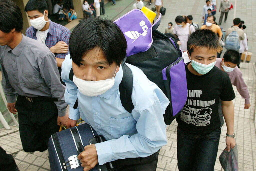 Migrant workers leaving China during a Sars outbreak