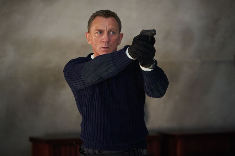 James Bond (Daniel Craig) prepares to shoot in NO TIME TO DIE. (Credit: Nicola Dove/MGM)