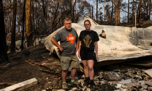 Dafydd Gwynn-Jones and his daughter Caitlin by their family's destroyed property in North Rosedale.