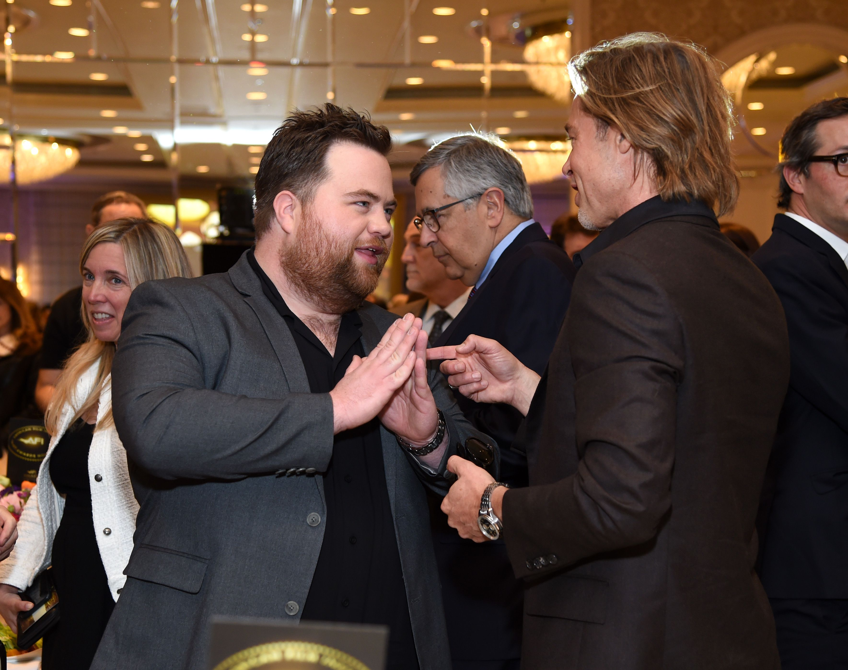 LOS ANGELES, CALIFORNIA - JANUARY 03: Actors Paul Walter Hauser and Brad Pitt attend the 20th Annual AFI Awards at Four Seasons Hotel Los Angeles at Beverly Hills on January 03, 2020 in Los Angeles, California. (Photo by Michael Kovac/Getty Images for AFI)