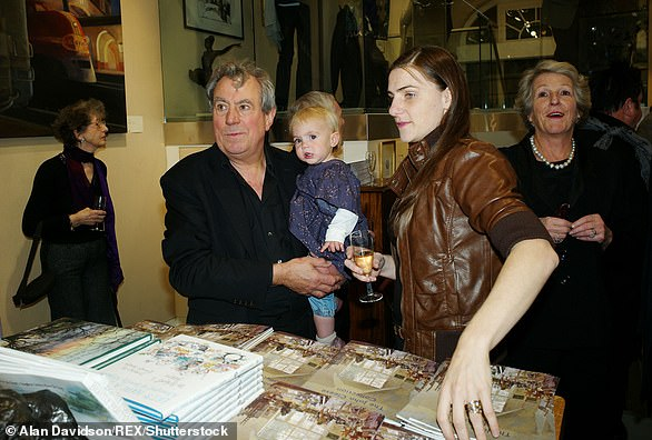 Jones introduces his wife Anna Soderstrom and their daughter Siri to Cleese in 2010