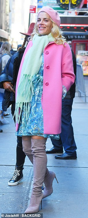 Colorful: Outside the studio, Busy was snapped on her way in, adding a pastel pink beret and lovely deeper pink coat to her colorful outfit