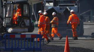 Construction workers work near the Excel Centre, London in the Docklands as the spread of the coronavirus disease (COVID-19) continues, London, Britain, March 24, 2020.