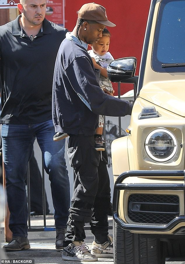 Back together? Kylie Jenner added fuel to rumors she and Travis Scott are back together Saturday when they stepped out with daughter Stormi in Calabasas