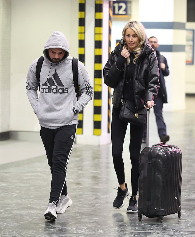 Casual:The TOWIE star, 28, kept it casual as she stepped out in a black top, which she wore with a cosy black padded jacket and trainers