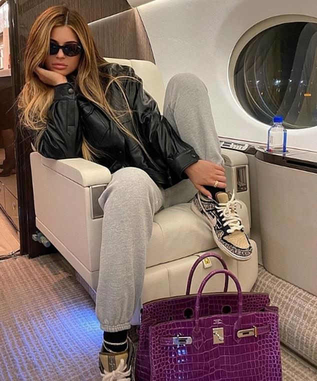 Cool kicks: Eagle-eyed followers noticed her wearing Scott's unreleased Cactus Jack Nike SB Dunk Lows in a photo on her private jet, captioned: 'Brb baby'