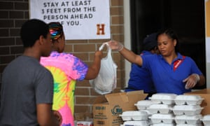 Paul Habans Charter School hands out supplies including food, books and computers to students and the community as Louisiana schools close for one month due to the spread of coronavirus on March 17, 2020 in New Orleans, Louisiana.