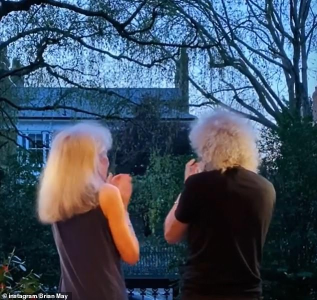 Cheers: Queen rocker Brian May, 72, joined actress wife Anita Dobson on their doorstep to show their appreciation