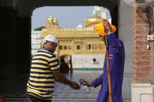 A devotee gets his hands sanitised as he visits the Golden Temple, the holiest of Sikh places, in Amritsar, India.