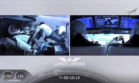 Astronaut Bob Behnken is seen with a toy dinosaur on board Falcon 9 last month.