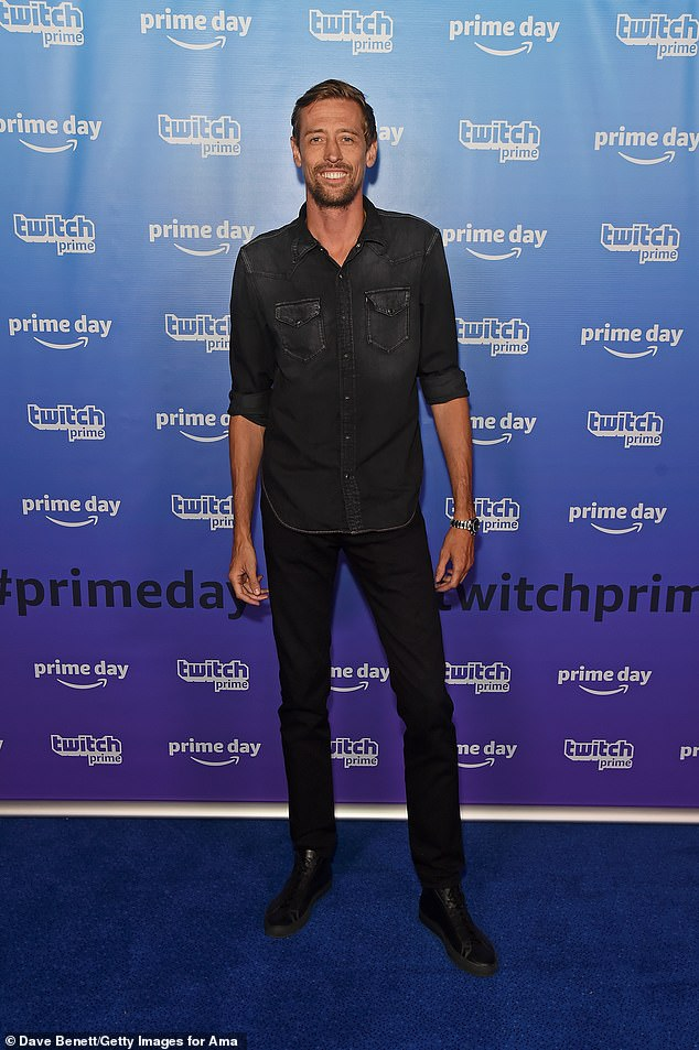 Smart: Peter Crouch opted for a smart casual look, sporting a faded black denim shirt and black jeans