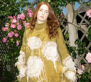 Amy Goacher's 'slow-fashion' knitwear, modelled by a friend in her garden.