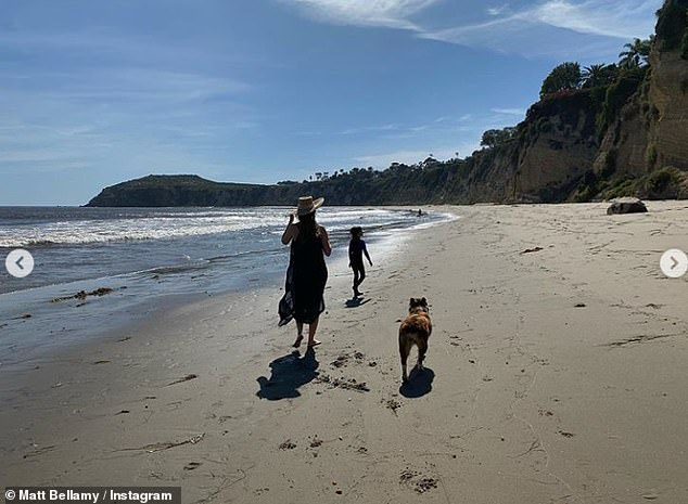 Excited: Matt gushed about their baby girl's imminent arrival as he posted the snaps of them enjoying a walk along the beach