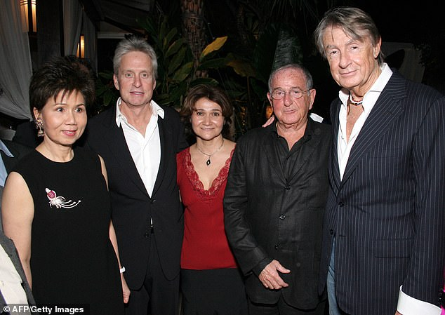 Famous friends: Joel (far right) poses in 2005 with actor Michael Douglas in Bangkok