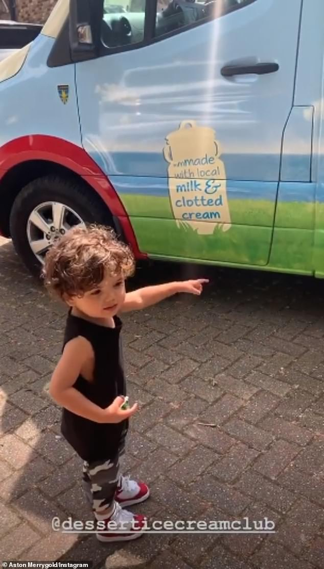 That's my boy:The star later treated his boy Grayson to a visit from an ice cream van after arranging for it to come to his home, with the tot clearly excited by the arrival as he pointed to the van