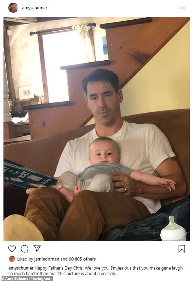 Happy moments:She also shared a photo of husband Chris Fischer and their son Gene captioned: 'Happy Father's Day Chris. We love you. I'm jealous that you make gene laugh so much harder than me. This picture is about a year old'