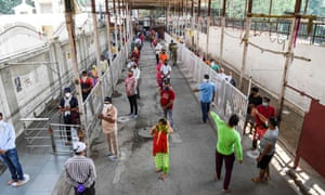 Hindu devotees wait in lines to pray at the Jhandewala temple in New Delhi as places of religious worship, hotels, restaurants and shopping malls in India were allowed to operate again.