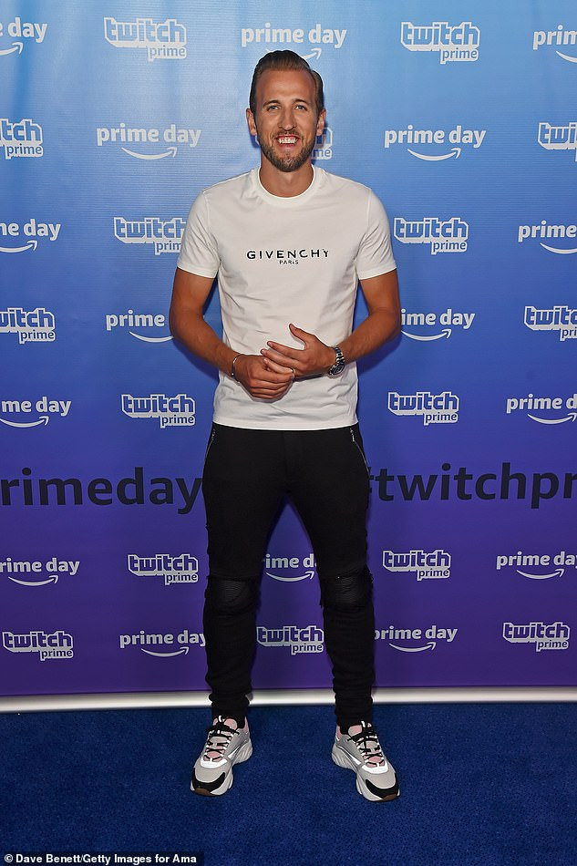 Dapper: Harry Kane showed off his rippling physique in a Givenchy T-shirt he paired with trainers