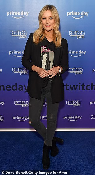Chic: Laura, 34, opted for grunge-chic in a Cher T-shirt which she wore under a structured black blazer