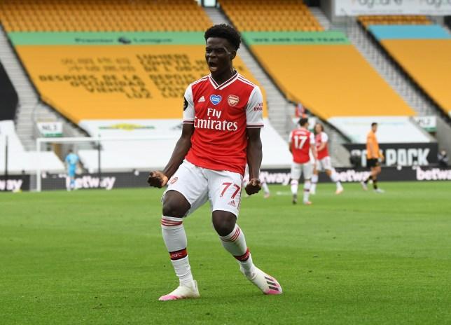 Bukayo Saka celebrates scoring Arsenal's opening goal in their Premier League win at Wolves