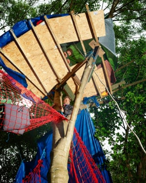 Putting down roots: Seb and Larch Maxey in their treehouse in Colne Valley.