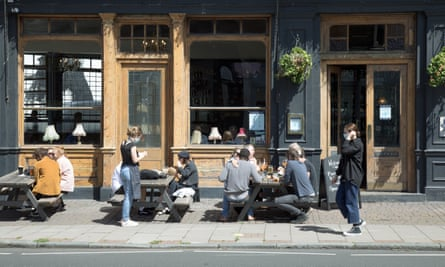 Customers at the East Dulwich Tavern in south London on 5 July, the day after pubs in England were allowed to reopen.