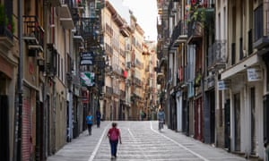 People walk through Pamplona's old town in the early morning, when, if it had been held, at noon the start of the festival San Fermin would have begun.