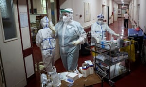 """Medical workers bring medications to patients suffering from coronavirus disease (COVID-19) inside the Institute for Orthopaedic Surgery """"Banjica"""", recently transformed to a Covid hospital, in Belgrade, Serbia. The small Balkan country is experiencing a resurgence of the pandemic."""