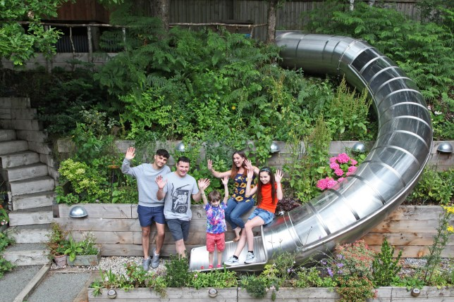 Family standing by the slide in their garden