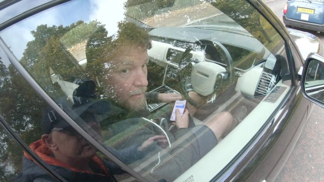 Film director Guy Ritchie seen texting behind the wheel