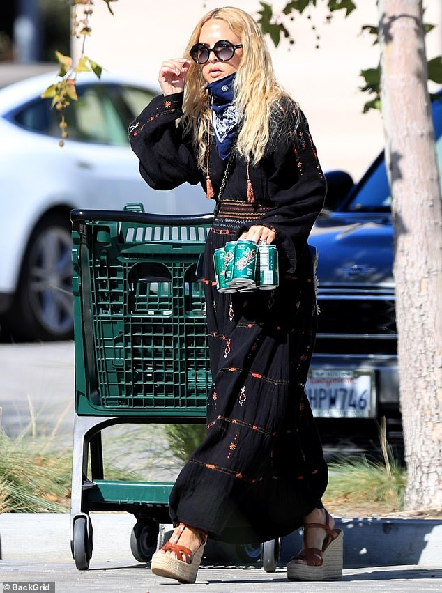 Trendy: Rachel Zoe commanded attention with her stylish ensemble as she ventured out for a grocery run on Tuesday in Malibu. She was also carrying the zero calorie drink Zevia
