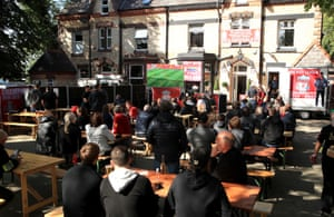 Fans watch the match outside the Hotel Tia near Anfield.