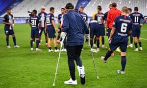 Kylian Mbappé on crutches at the end of the match.