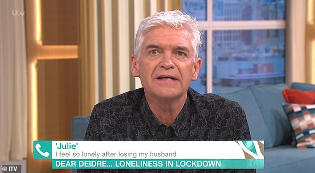 Sad:Phillip Schofield, 58, admitted the pain of his father's death 'never goes away' during a heartbreaking This Morning phone-in on Thursday
