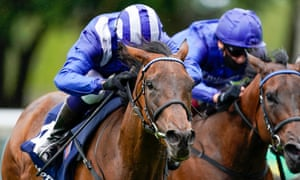 Jim Crowley rides Nazeef (blue/white cap) to victory in the Tattersalls Falmouth Stakes at Newmarket.