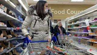 Woman shopping at Tesco