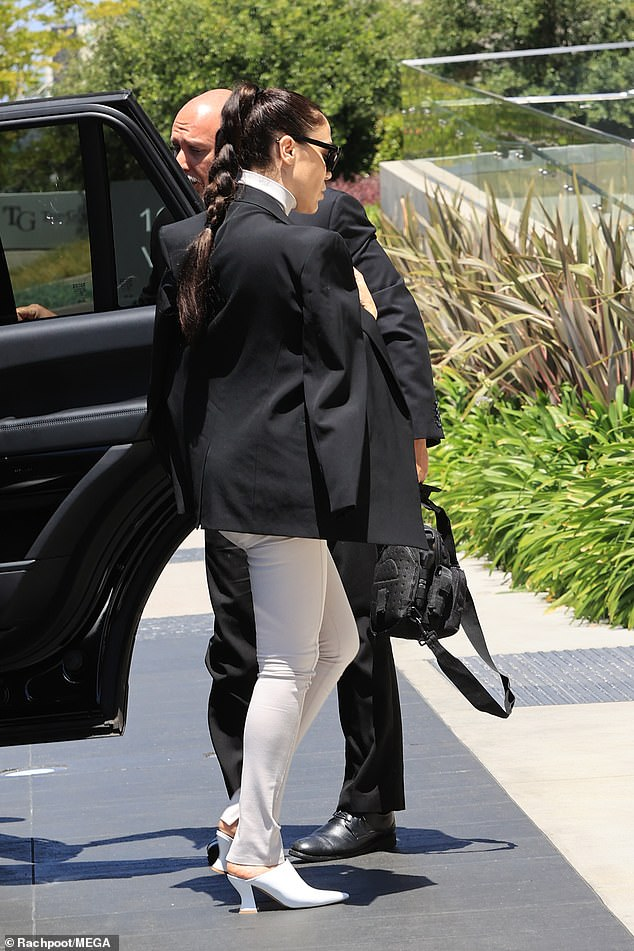 Hashing it out: Nicole spent three hours at the attorney's office on Thursday