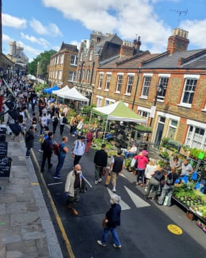 Columbia Road flower market reopens in east London on Sunday with social distancing measures including spacing out stalls on one side of the street only.