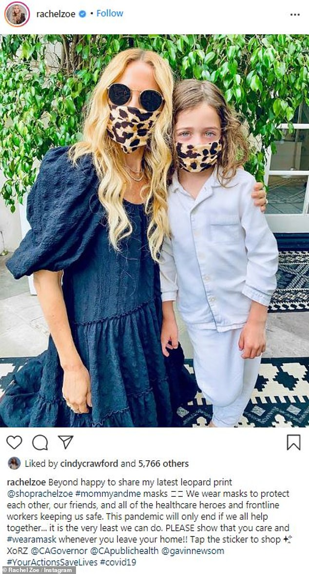 Safe: She showed off her '#mommyandme mask' collection with an adorable snap of herself and six-year-old son, Kaius, wearing matching leopard print cloth coverings on Wednesday