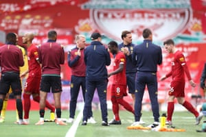 Aston Villa players give Liverpool players a guard of honour as they walk out.