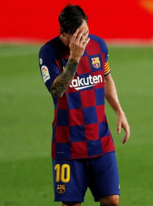 Leo Messi looks dejected after Barcelona's defeat at home to Osasuna.