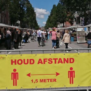 Social distancing signs at De Pijp market.