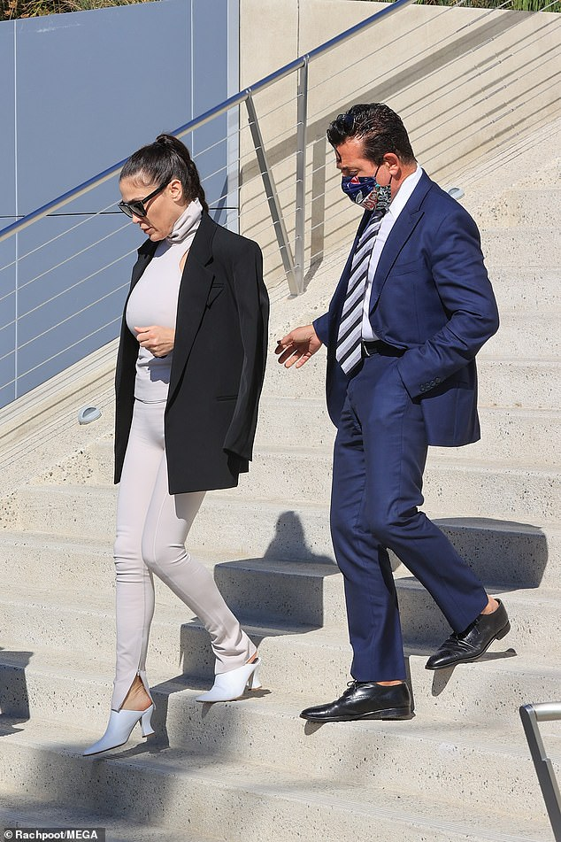 Heading out: Nicole looked ready for business in her blush outfit and white heels. She pulled her hair up in a high braided pony and donned some stylish shades