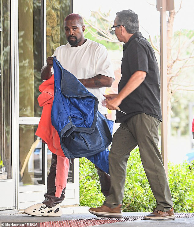Tough times: Kayne had reportedly been 'ghosting' the mother-of-four since a series of internet outbursts last week, where he said he had been 'trying to get divorced' from the star, hinted she had cheated and accused her of trying to get a 'doctor to lock [him] up.' He's seen last Saturday above