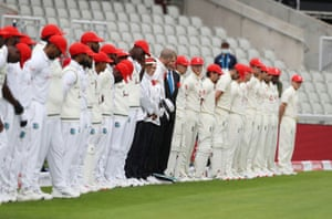 The teams line up before the start of play.