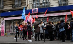 Workers and General Confederation of Labour (CGT) members protest outside the Tati department store in the Barbès district of Paris in May 2017.