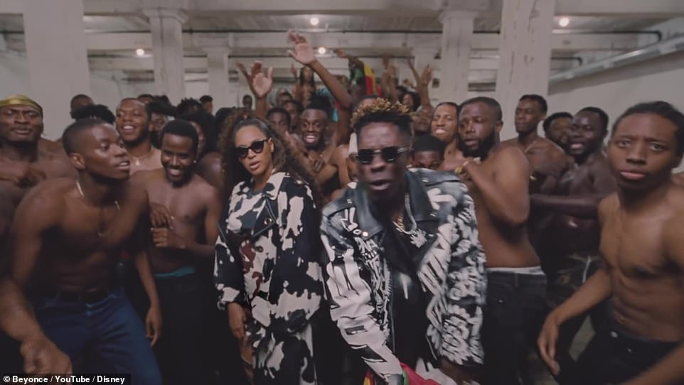 Shatta Wale:She's joined by Shatta Wale takes over the next verse as Queen Bey rocks a number of different outfits, including a splotchy black and white ensemble with short shorts and a regal teal dress that matches the body paint